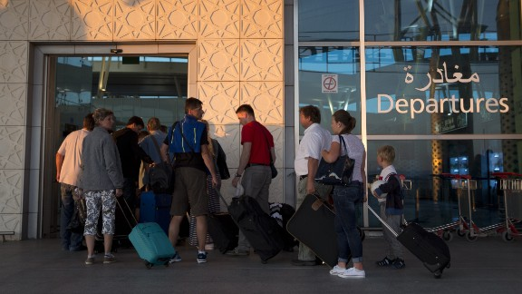 Tourists leave Tunisia at the Enfidha International airport a day after the attack.