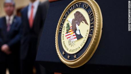 US Department of Justice seal is displayed on a podium during a news conference to announce money laundering charges against HSBC on December 11, 2012 in the Brooklyn borough of New York City.