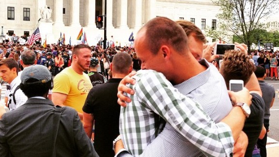 """Alex Orton hugs boyfriend Rob Snyder after hearing the Supreme Court ruling. """"What an amazing day for the United States and for LGBT people across the nation,"""" he said."""