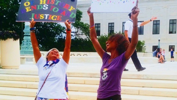 """Kristen Nichole captured this photo of two women celebrating the decision to legalize same-sex marriage nationwide on Friday. """"So excited to be on the steps of the Supreme Court today supporting the equal marriage decision!"""" she said via Instagram"""