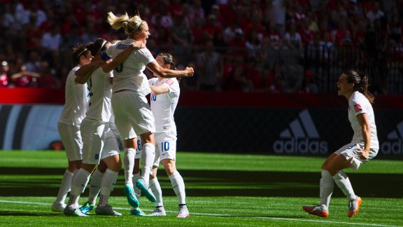 England players celebrate a goal during their 2-1 victory over Canada in the Women