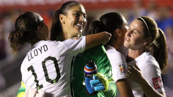 Hope Solo celebrates with Carli Lloyd after defeating China 1-0 in the FIFA Women's World Cup 2015 Quarter Final match in June 2015.