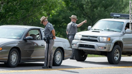 MALONE, NY - JUNE 27:  New York State Police officers man a roadblock along Highway 30 as the manhunt for escaped convict David Sweat continues on June 27, 2015 near Malone, New York. Yesterday Richard Matt, who escaped with Sweat, was shot and killed in the same by area, which is about 8 miles south of the town of Malone. More than 1,000 State Police, Border Patrol, correction officers, FBI and others have been searching for the pair since they were discovered missing from a prison in nearby Dannemora on June 6.  (Photo by Scott Olson/Getty Images)