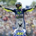 rossi stands on bike