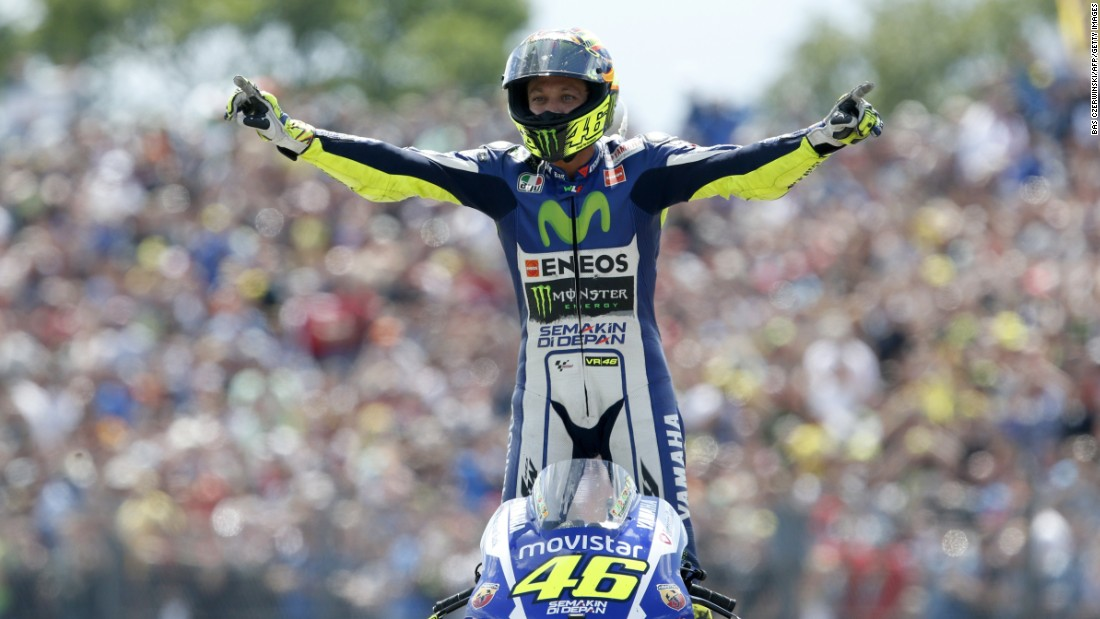 Valentino Rossi celebrates after winning the Dutch Grand Prix at Assen, his third victory this season.