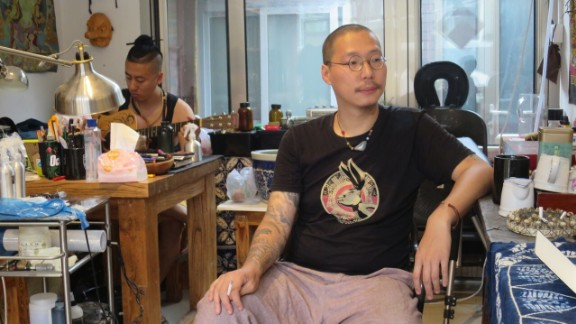 Chinese tattoo artist Da Hua at his studio. He first started out practicing his designs on pig skin bought at the local market.