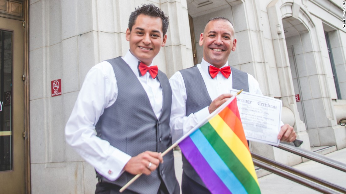 "David Herrera-Santos, left, and Carlos Santos-Herrera, right, hold their marriage certificate on the steps of an Atlanta courthouse. Photos by Kelly Embry (<a href=""www.kellyembryphoto.com"" target=""_blank"">www.kellyembryphoto.com</a>)."