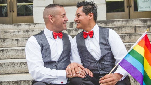 """Carlos Santos-Herrera and David Herrera-Santos  celebrate their union. """"When we heard the news this morning, I jumped up, and I started screaming,"""" Santos-Herrera said. """"I called (my fiancé) up and said: 'We need to get married now. Forget about Florida.' """""""