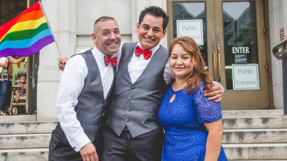 Carlos Santos-Herrera and David Herrera-Santo stand with David's sister, moments after they wed.