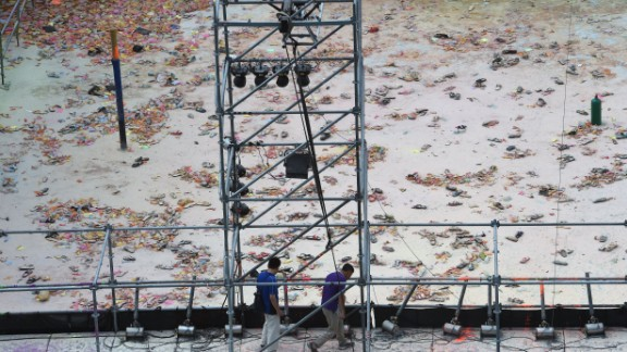 Two men walk at the explosion site of the water park in the Pali district in New Taipei City, Taiwan, on June 28.