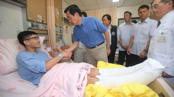 Taiwanese President Ma Ying-jeou shakes hands with a victim on Sunday, June 28. The New Taipei City fire department says 200 people were injured in an accidental explosion of colored theatrical powder near a performance stage where about 1,000 people gathered for party on June 27.