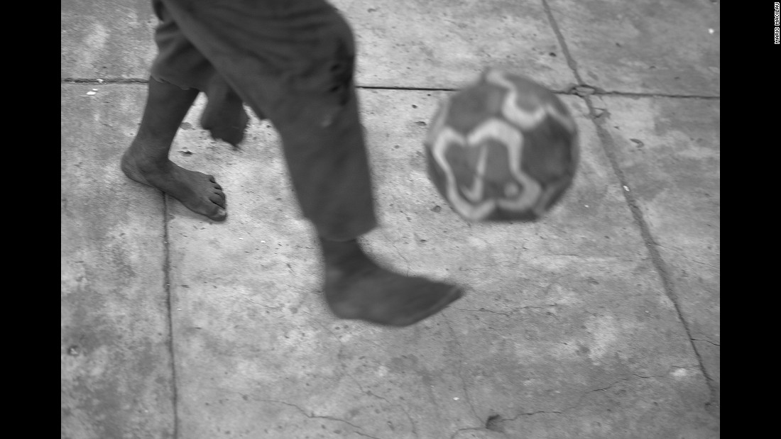 A child plays soccer in his home in the abandoned Vila Algarve building.