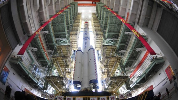 The Shenzhou X spacecraft, carried by a Long March-2F carrier rocket, is installed at the launch pad in Jiuquan, China, in June 2013. The spacecraft carried three astronauts to visit the Tiangong-1 space module. China's space program has launched more than 130 systems in the past few years, including spy satellites and a new navigation system that would provide an alternate to GPS.