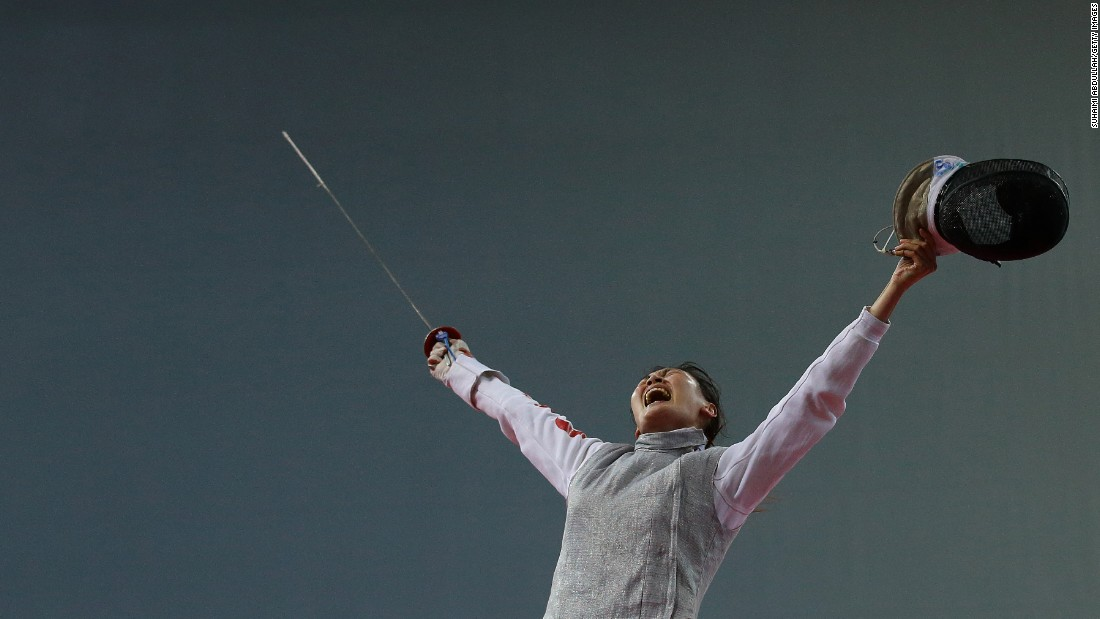 China's Chen Qinghui celebrates a victory at the Asian Fencing Championships on Saturday, June 27.