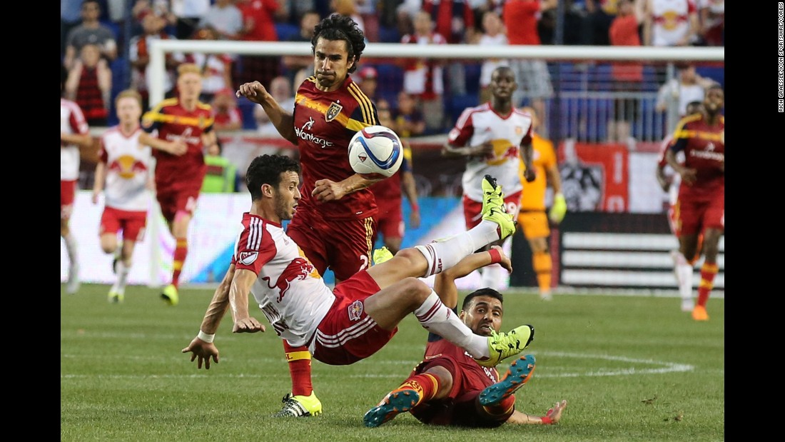 New York Red Bulls forward Felipe is tackled by Real Salt Lake's Javier Morales during a Major League Soccer game Wednesday, June 24, in Harrison, New Jersey. Morales received a red card on the play.