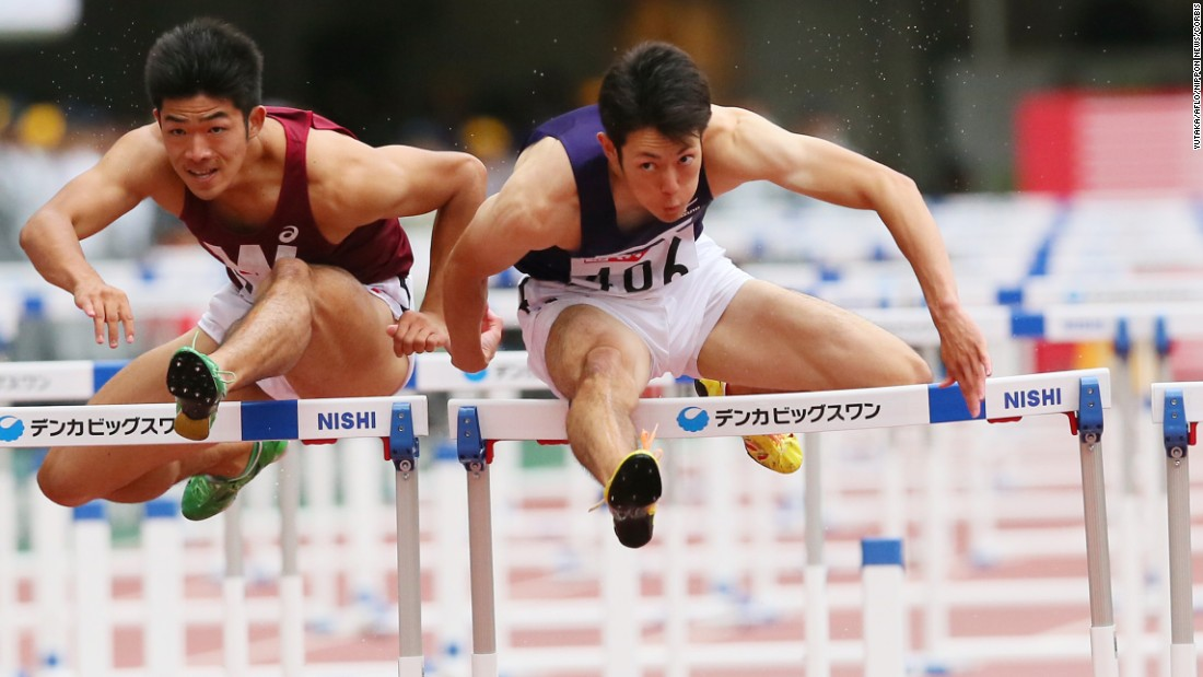 Takumu Furuya, left, and Shunya Takayama race in the 110-meter hurdles during Japan's Track and Field Championships on Sunday, June 28.