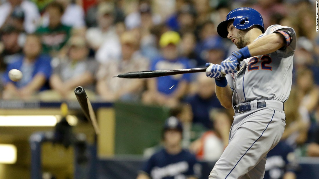 Kevin Plawecki of the New York Mets breaks his bat while grounding out against Milwaukee on Tuesday, June 23.