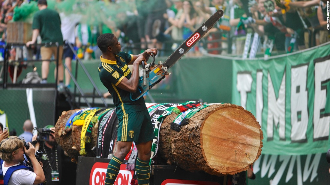 Portland's Fanendo Adi celebrates a goal by picking up a chainsaw on Sunday, June 28. The chainsaw is traditionally wielded by the Timbers' mascot, Timber Joey, who cuts a log slab after each goal.