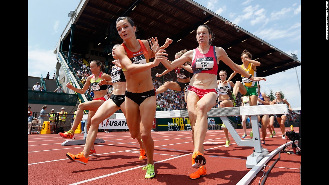 Ashley Higginson and Shalaya Kipp nearly fall Saturday, June 27, as they compete in the 3,000-meter steeplechase at the U.S. Track and Field Championships.