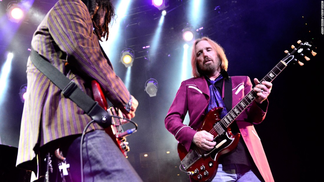 "This band chose ""American Girl"" as the first song to be played at Live Aid's U.S. venue, JFK Stadium in Philadelphia. Tom Petty, right, here playing with longtime band mate Mike Campbell in 2014, launched a 40th anniversary tour in 2017."