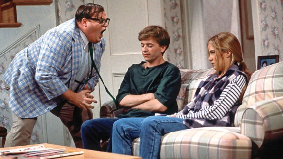 Chris Farley (at left with David Spade and Christina Applegate) was found dead of a drug overdose on December 18, 1997. He was 33 years old.