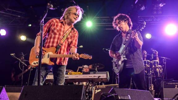 """Not only did singer/guitarist Daryl Hall, left, and singer/guitarist John Oates perform at Live Aid, they also backed up R&B legends Eddie Kendricks and David Ruffin. Hall & Oates were inducted into the Rock and Roll Hall of Fame in 2014. Recently Hall hosted a popular cable TV series, """"Live From Daryl's House,"""" that featured him jamming with guest musicians. Hall & Oates are seen here performing in 2014 at Henham Park in Southwold, England."""