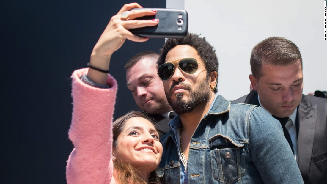 "A fan takes a picture with musician Lenny Kravitz in Wetzler, Germany, on Tuesday, June 23. <a href=""http://us.leica-camera.com/World-of-Leica/Leica-Galleries/Leica-Gallery-Wetzlar/News-Program/2015/Flash-by-Lenny-Kravitz"" target=""_blank"">An exhibition for Kravitz's photo book ""Flash""</a> is on display at the Leica Gallery in Wetzler."