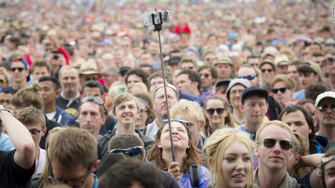 A concertgoer uses a selfie stick at the Glastonbury Festival in England on Friday, June 26.