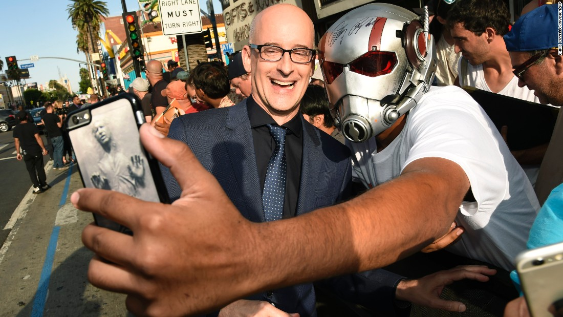 """Ant-Man"" director Peyton Reed poses for a fan's selfie at the film's premiere in Los Angeles on Monday, June 29."