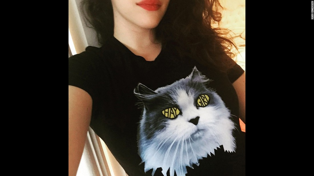 "Behrs' ""2 Broke Girls"" co-star, Kat Dennings, shows off a new shirt she designed on Monday, June 29. ""The kitty in the photo is my dearly departed Pumpkin, who was a stray before my family adopted her,"" <a href=""https://instagram.com/p/4h245aiND1/"" target=""_blank"">Dennings said on Instagram.</a> ""So a huge percentage of <a href=""https://represent.com/kat"" target=""_blank"">every shirt sold</a> goes to the North Shore Animal League, who does amazing work for saving homeless animals."""