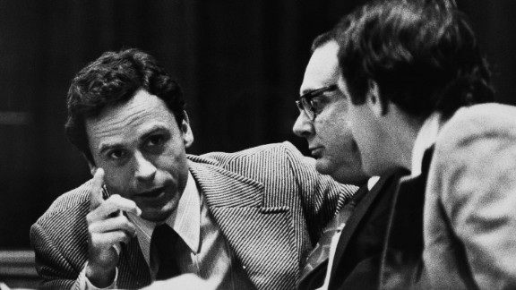 """Theodore """"Ted"""" Bundy, left, makes a point to members of his defense team at his trial in Miami in June 1979.  Bundy raped and killed at least 16 young women in the early to mid-1970s, and was convicted of three Florida slayings, including that of a 12-year-old girl. He later confessed to killing more than 30 women and girls. """"He was handsome, he was very involved with politics, he was educated, he was in law school. It didn"""