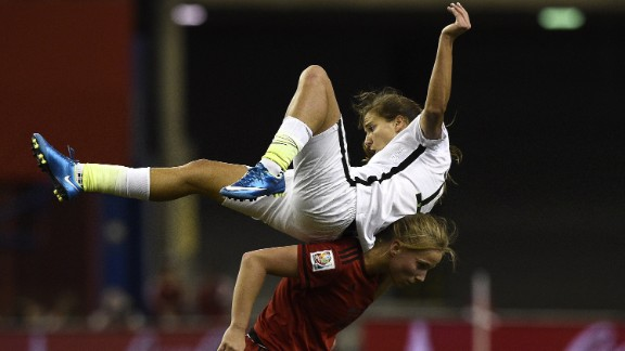 U.S. midfielder Tobin Heath gets knocked over by Germany