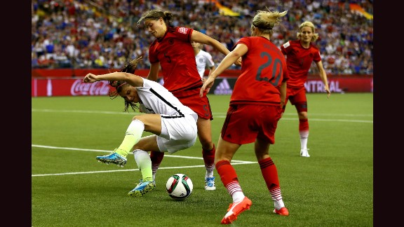 U.S forward Alex Morgan is defended by Germany