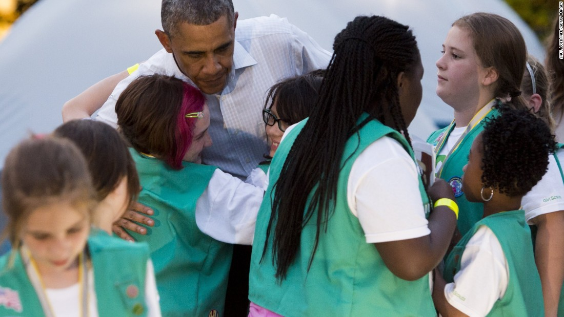 "As the President got ready to leave for the night, he told the Girl Scouts ""You guys are having so much fun, but unfortunately, I've got to go to work."" Some Girl Scouts were not pleased, but Obama quickly added ""but we can have a group hug,"" and all 50 Scouts swarmed around him."