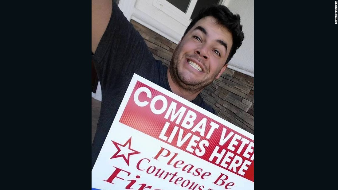 The signs ask that neighbors be courteous with fireworks near the Fourth of July by warning combat veterans. Vets like Chris Dumont, pictured above, may experience symptoms of PTSD due to the loud, explosive noises.
