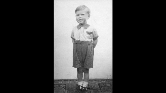 """Long before his days as a stadium-packing musician, Mick Jagger is seen at his home in Dartford, England, in 1946. He was 3 years old. Images like this, along with hundreds of other Rolling Stones artifacts, will be on display as part of """"Exhibitionism,"""" a gallery that opens at London"""