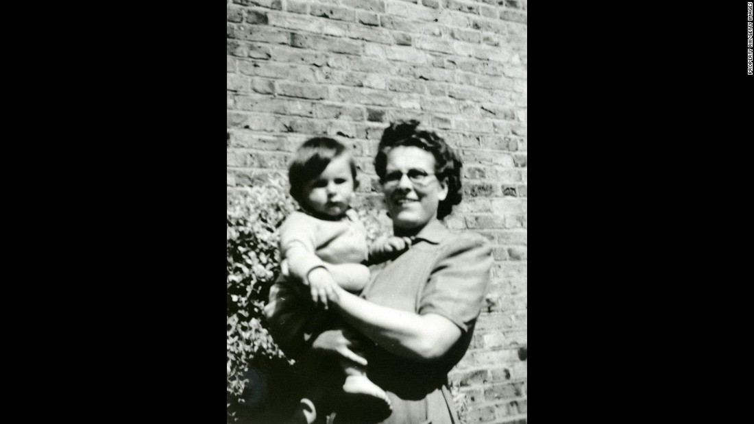 Ronnie Wood, 9 months old, is held by his mother, Elizabeth, in 1947. Wood joined the Stones in 1975, and he is known for playing the slide guitar and the lap-steel guitar.