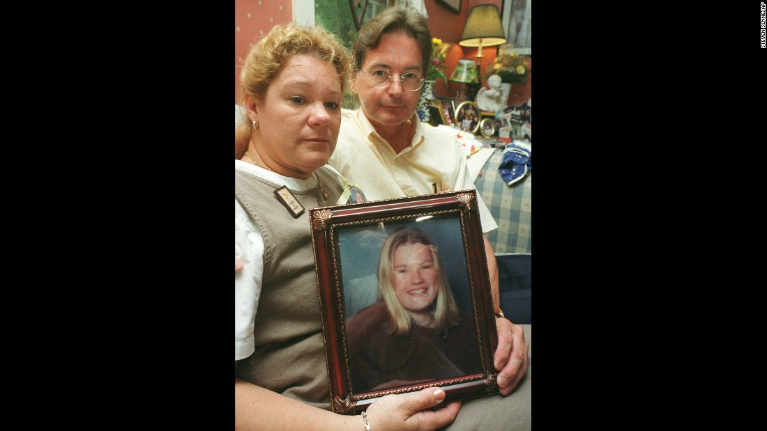 The parents of Molly Bish hold a photo of their daughter. Bish's mother dropped her off for work in June 2000. Molly was never seen alive again. The lifeguard's remains were recovered three years later.