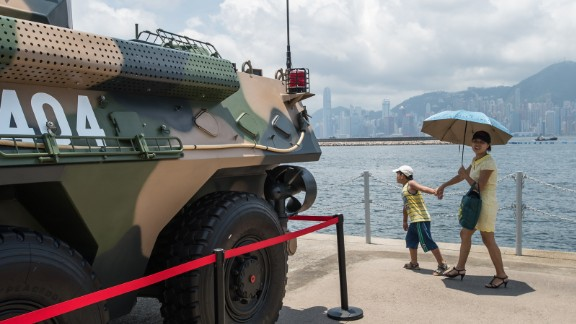 It's an unusual military display next to Hong Kong's typically placid harbor.