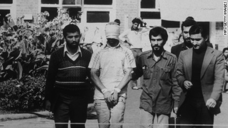 An American hostage being paraded before the cameras by his Iranian captors. Following the Iranian revolution over fifty American hostages were taken and only released after four hundred and forty-four days.