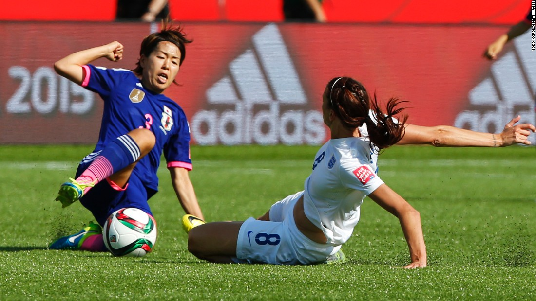 Jill Scott of England and Azusa Iwashimizu of Japan slide in for the ball.