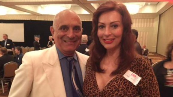 Chuck de Caro and his wife, Lynne Russell, celebrate at a CNN anniversary party in June.