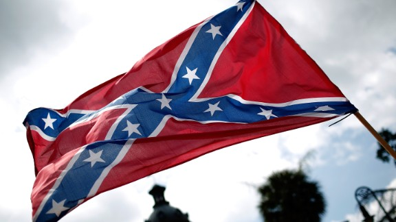 COLUMBIA, SC - JUNE 27:  Demonstrators protest at the South Carolina State House calling for the Confederate flag to remain on the State House grounds June 27, 2015 in Columbia, South Carolina. Earlier in the week South Carolina Gov. Nikki Haley expressed support for removing the Confederate flag from the State House grounds in the wake of the nine murders at Mother Emanuel A.M.E. Church in Charleston, South Carolina.  (Photo by Win McNamee/Getty Images)