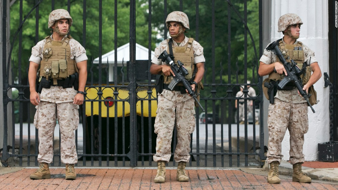 "Soldiers guard the Navy Barracks in Washington on Thursday, July 2. Reports of a man with a gun put the Washington Navy Yard campus on lockdown, authorities said. The complex is the site of a deadly 2013 mass shooting. Federal law enforcement later gave the ""all-clear."""