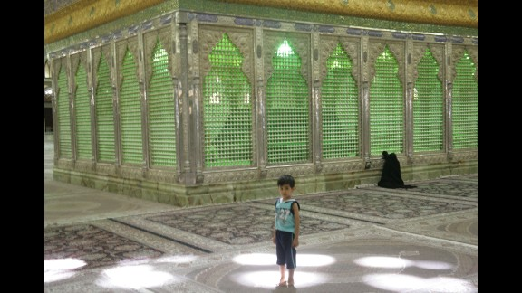 Children play in the shrine while their mothers pray or pay their respects to the late ayatollah.
