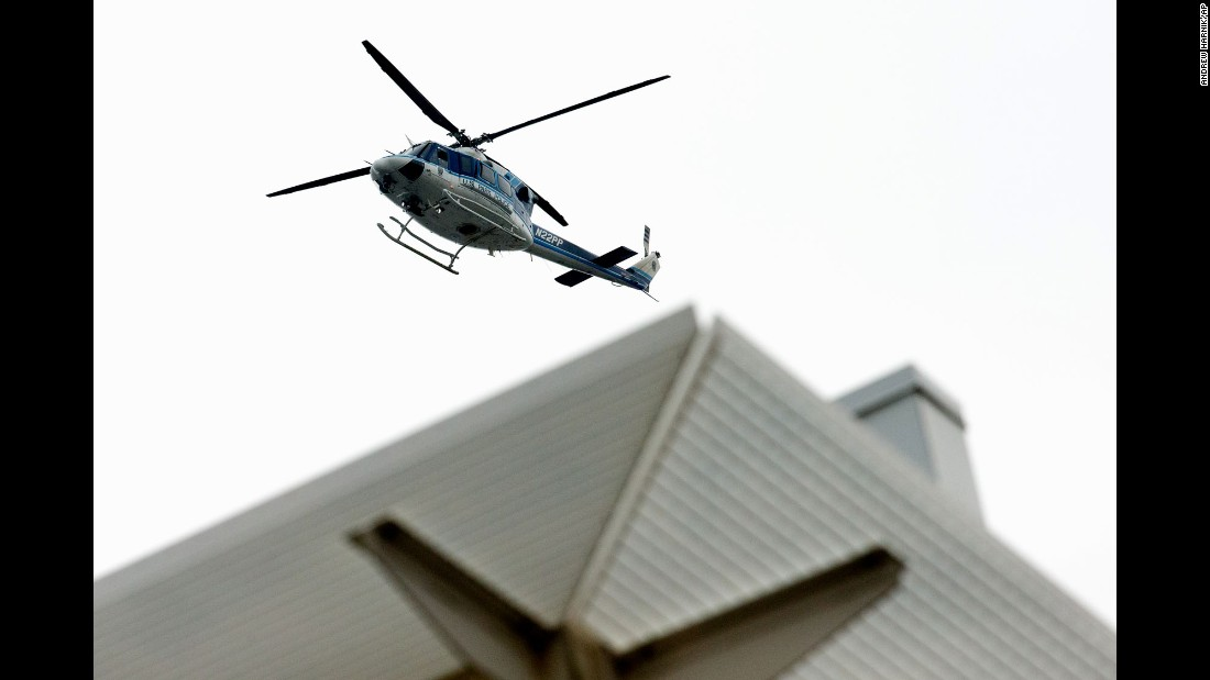 A U.S. Park Police helicopter hovers overhead at the Navy Yard facility in southeast Washington on July 2.
