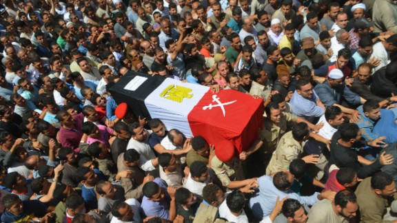 People in Ashmoun, Egypt, carry the coffin for 1st Lt. Mohammed Ashraf, who was killed when the ISIS militant group attacked Egyptian military checkpoints on Wednesday, July 1. At least 17 soldiers were reportedly killed, and 30 were injured.
