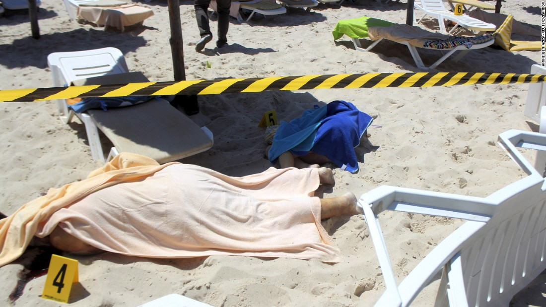 "Dead bodies lie near a beachside hotel in Sousse, Tunisia, after <a href=""http://www.cnn.com/2015/06/26/world/gallery/tunisia-terrorist-attack/index.html"" target=""_blank"">a gunman opened fire</a> on Friday, June 26. At least 38 people were killed in the rampage."