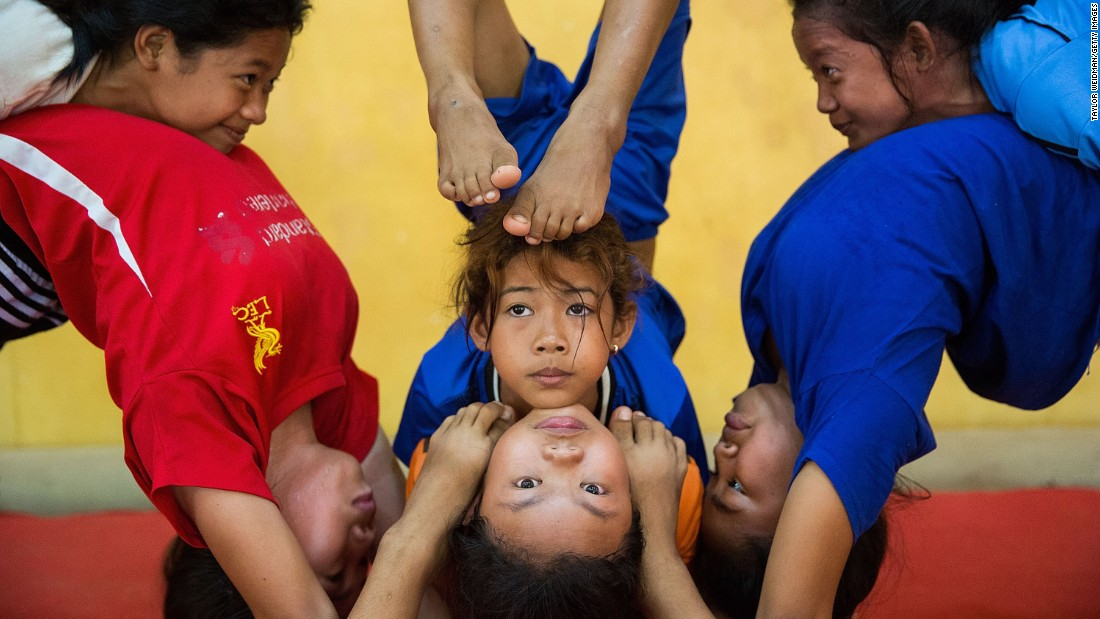 Young circus students practice in Battambang, Cambodia, on Wednesday, July 1.