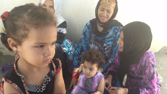Women and children gather in Al Zuhour district in Kasserine.